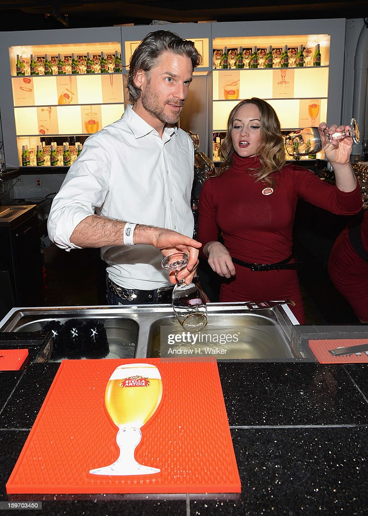 Actor Noah Huntley pours beer at the Stella Artois launch of the Timeless Beauty Campaign shot by legendary photographer, Annie Leibovitz at Village at the Lift on January 18, 2013 in Park City, Utah.