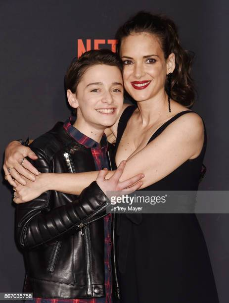 Actor Noah Schnapp and actress Winona Ryder arrive at the Premiere Of Netflix's 'Stranger Things' Season 2 at Regency Westwood Village Theatre on...