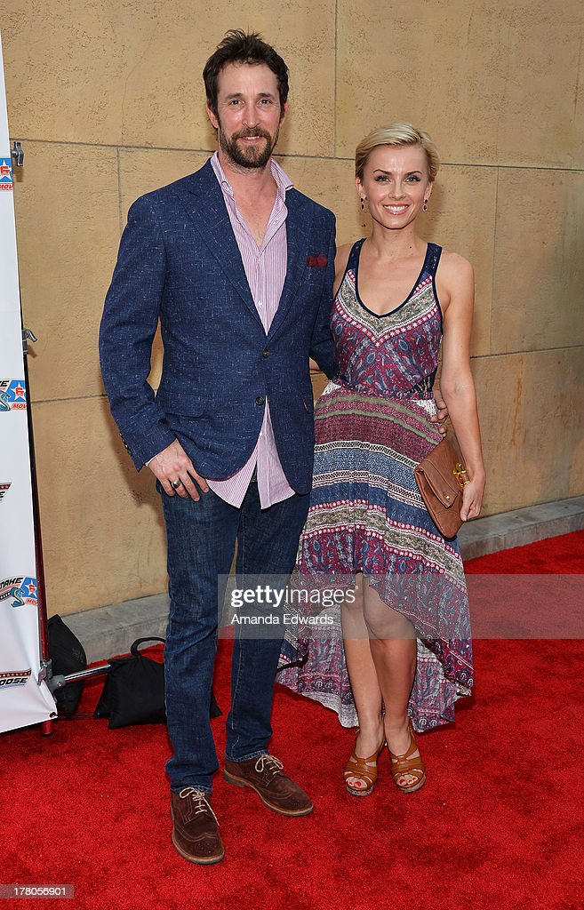 Actor <a gi-track='captionPersonalityLinkClicked' href=/galleries/search?phrase=Noah+Wyle&family=editorial&specificpeople=217263 ng-click='$event.stopPropagation()'>Noah Wyle</a> (L) and actress Sara Wells arrive at the premiere of 'Snake & Mongoo$e' at the Egyptian Theatre on August 26, 2013 in Hollywood, California.