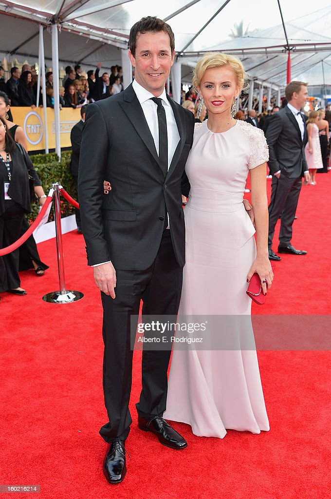 Actor Noah Wyle and Sara Wells arrive at the 19th Annual Screen Actors Guild Awards held at The Shrine Auditorium on January 27, 2013 in Los Angeles, California.