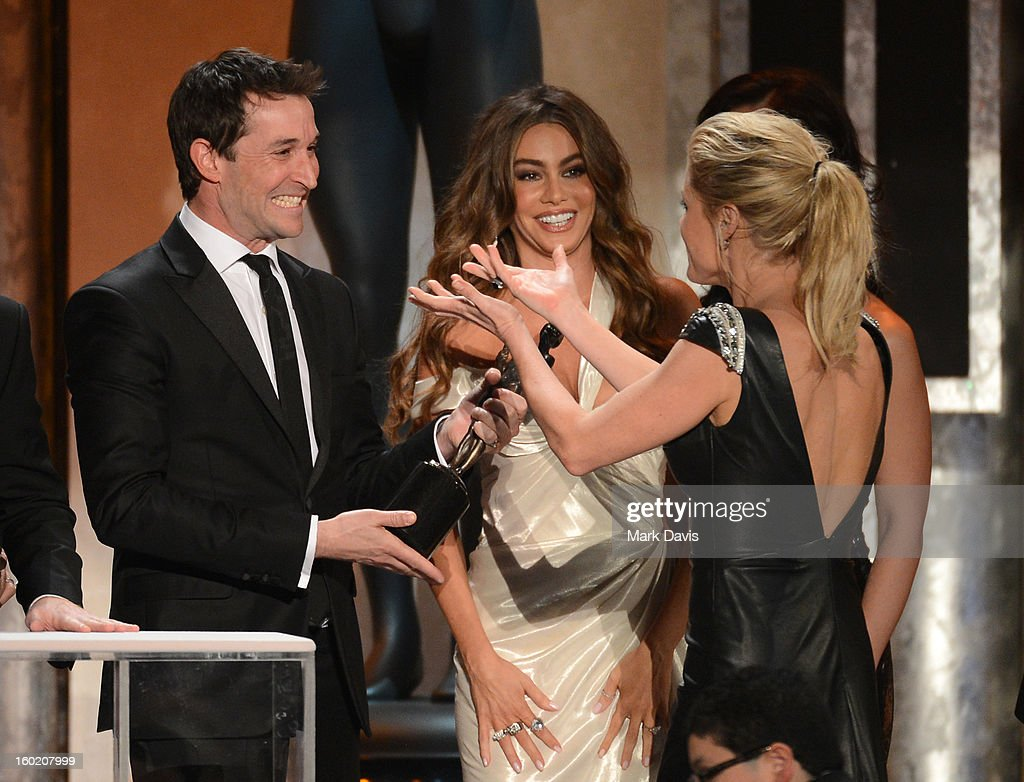 Actor Noah Wyle (L) presents the award for Outstanding Performance by an Ensemble in a Comedy Series to actors Sofía Vergara (C) and Julie Bowen (R) for 'Modern Family' onstage during the 19th Annual Screen Actors Guild Awards held at The Shrine Auditorium on January 27, 2013 in Los Angeles, California.