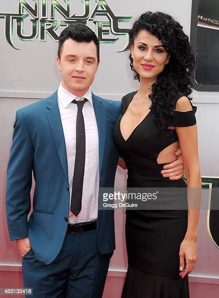 Actor Noel Fisher and Layla Alizada arrive at the Los Angeles Premiere of 'Teenage Mutant Ninja Turtles' at Regency Village Theatre on August 3 2014...