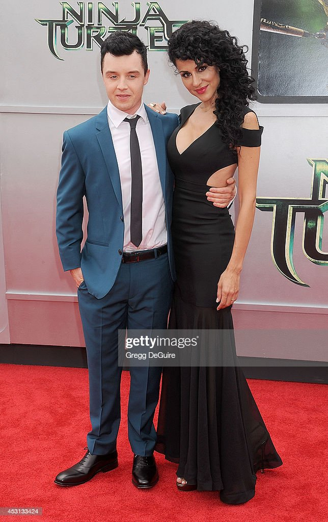 Actor Noel Fisher and Layla Alizada arrive at the Los Angeles Premiere of 'Teenage Mutant Ninja Turtles' at Regency Village Theatre on August 3, 2014 in Westwood, California.