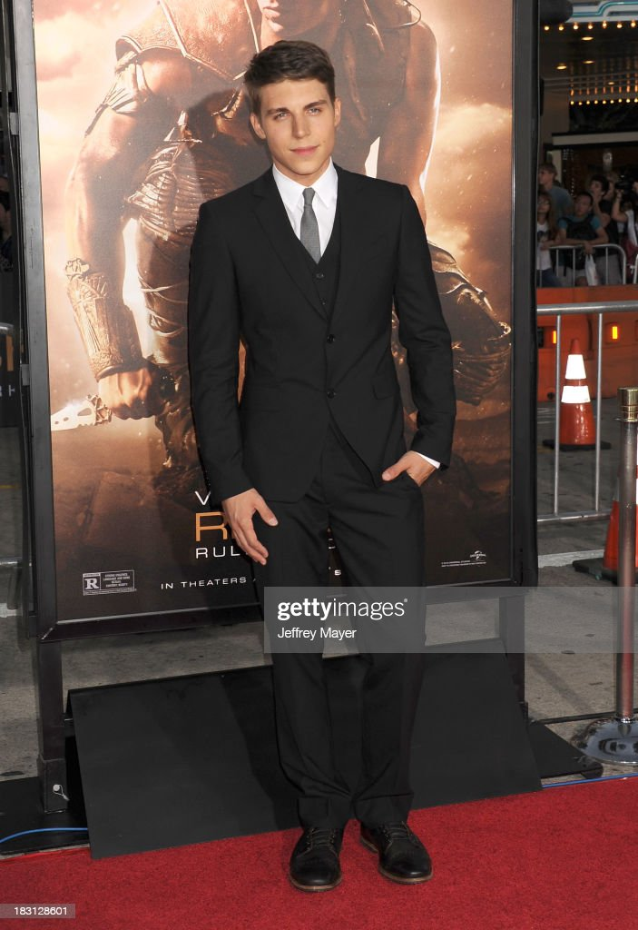 Actor <a gi-track='captionPersonalityLinkClicked' href=/galleries/search?phrase=Nolan+Gerard+Funk&family=editorial&specificpeople=5626391 ng-click='$event.stopPropagation()'>Nolan Gerard Funk</a> arrives at the Los Angeles premiere of 'Riddick' at the Westwood Village Theatre on August 28, 2013 in Westwood, California.