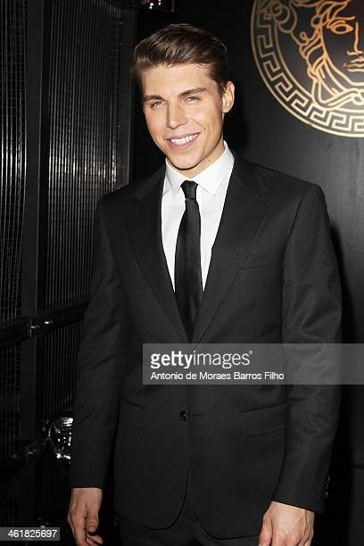 Actor Nolan Gerard Funk attends the Versace show as a part of Milan Fashion Week Menswear Autumn/Winter 2014 on January 11 2014 in Milan Italy
