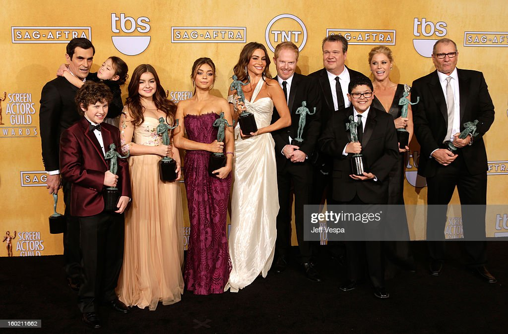Actor Nolan Gould, actor Ty Burrell, actress Aubrey Anderson-Emmons, actress Ariel Winter, actress Sarah Hyland, actress Sofia Vergara, actress Jesse Tyler Ferguson, actor Eric Stonestreet, actor Rico Rodriguez, actress Julie Bowen and actor Ed O'Neill pose in the press room during the 19th Annual Screen Actors Guild Awards held at The Shrine Auditorium on January 27, 2013 in Los Angeles, California.