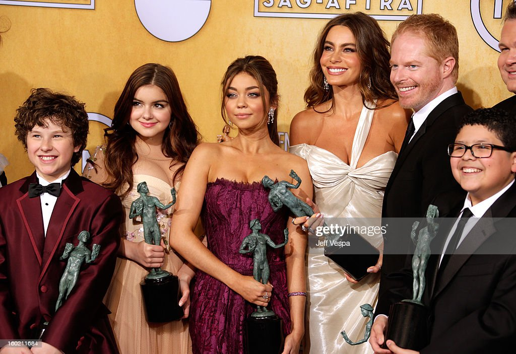 Actor Nolan Gould, actor Ty Burrell, actress Aubrey Anderson-Emmons, actress Ariel Winter, actress Sarah Hyland, actress Sofia Vergara, actress Jesse Tyler Ferguson, and actor Rico Rodriguezll pose in the press room during the 19th Annual Screen Actors Guild Awards held at The Shrine Auditorium on January 27, 2013 in Los Angeles, California.