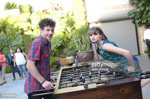 Actor Nolan Gould and actress Joey King attend Nolan Gould's 16th birthday party held at Smogshoppe on October 26 2014 in Los Angeles California