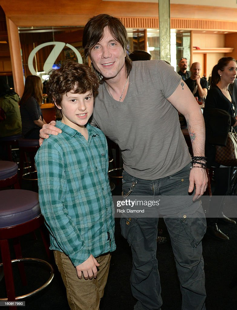 Actor Nolan Gould (L) and musician Johnny Rzeznik pose backstage at the GRAMMYs Dial Global Radio Remotes during The 55th Annual GRAMMY Awards at the STAPLES Center on February 7, 2013 in Los Angeles, California.