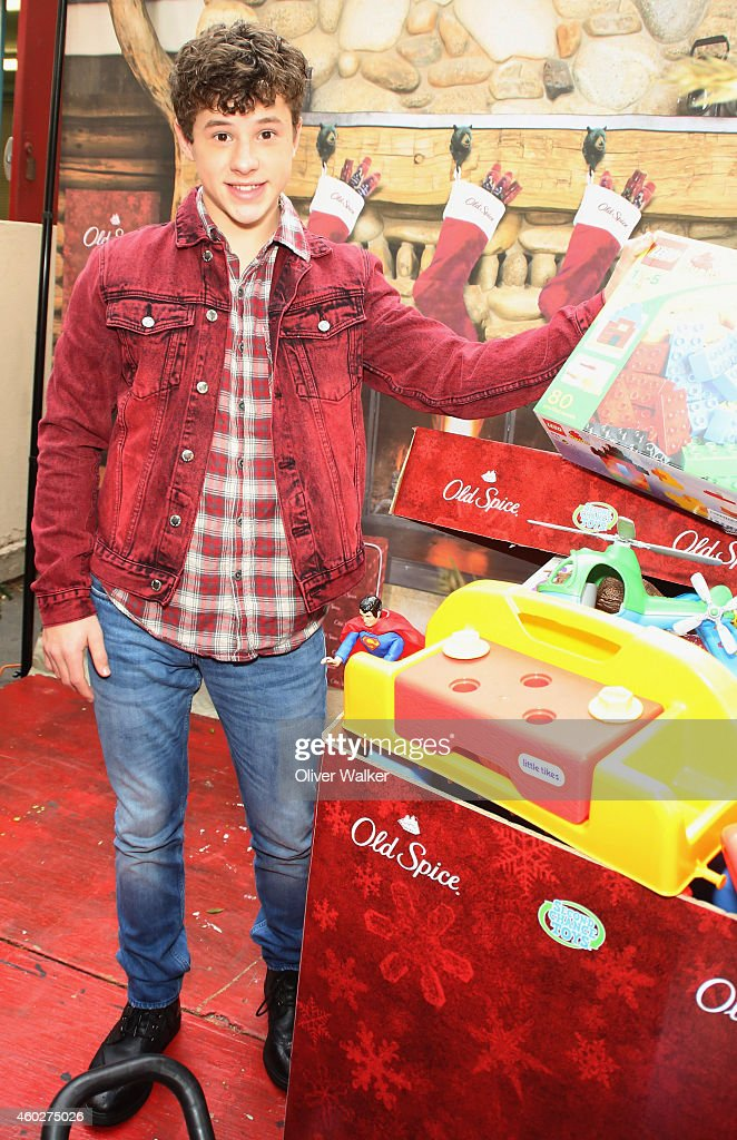 Actor <a gi-track='captionPersonalityLinkClicked' href=/galleries/search?phrase=Nolan+Gould&family=editorial&specificpeople=5691358 ng-click='$event.stopPropagation()'>Nolan Gould</a> attends the Inaugural Old Spice Holispray Holiday Toy Donation And Exchange Benefit For Second Chance Toys at Hollywood High School on December 10, 2014 in Los Angeles, California.