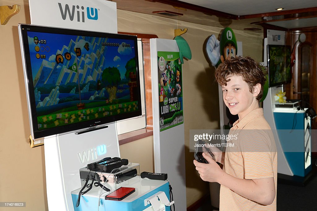 Actor <a gi-track='captionPersonalityLinkClicked' href=/galleries/search?phrase=Nolan+Gould&family=editorial&specificpeople=5691358 ng-click='$event.stopPropagation()'>Nolan Gould</a> attends the Nintendo Oasis on the TV Guide Magazine Yacht at Comic-Con day 1 on July 18, 2013 in San Diego, California.