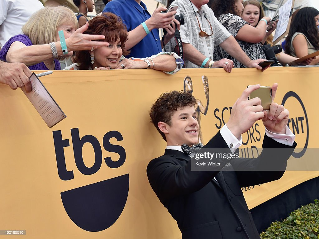 Actor <a gi-track='captionPersonalityLinkClicked' href=/galleries/search?phrase=Nolan+Gould&family=editorial&specificpeople=5691358 ng-click='$event.stopPropagation()'>Nolan Gould</a> attends TNT's 21st Annual Screen Actors Guild Awards at The Shrine Auditorium on January 25, 2015 in Los Angeles, California. 25184_017