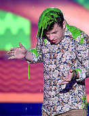 Actor Nolan Gould gets slimed as he accepts the award for Favorite Family TV Show for 'Modern Family' onstage during Nickelodeon's 28th Annual Kids'...