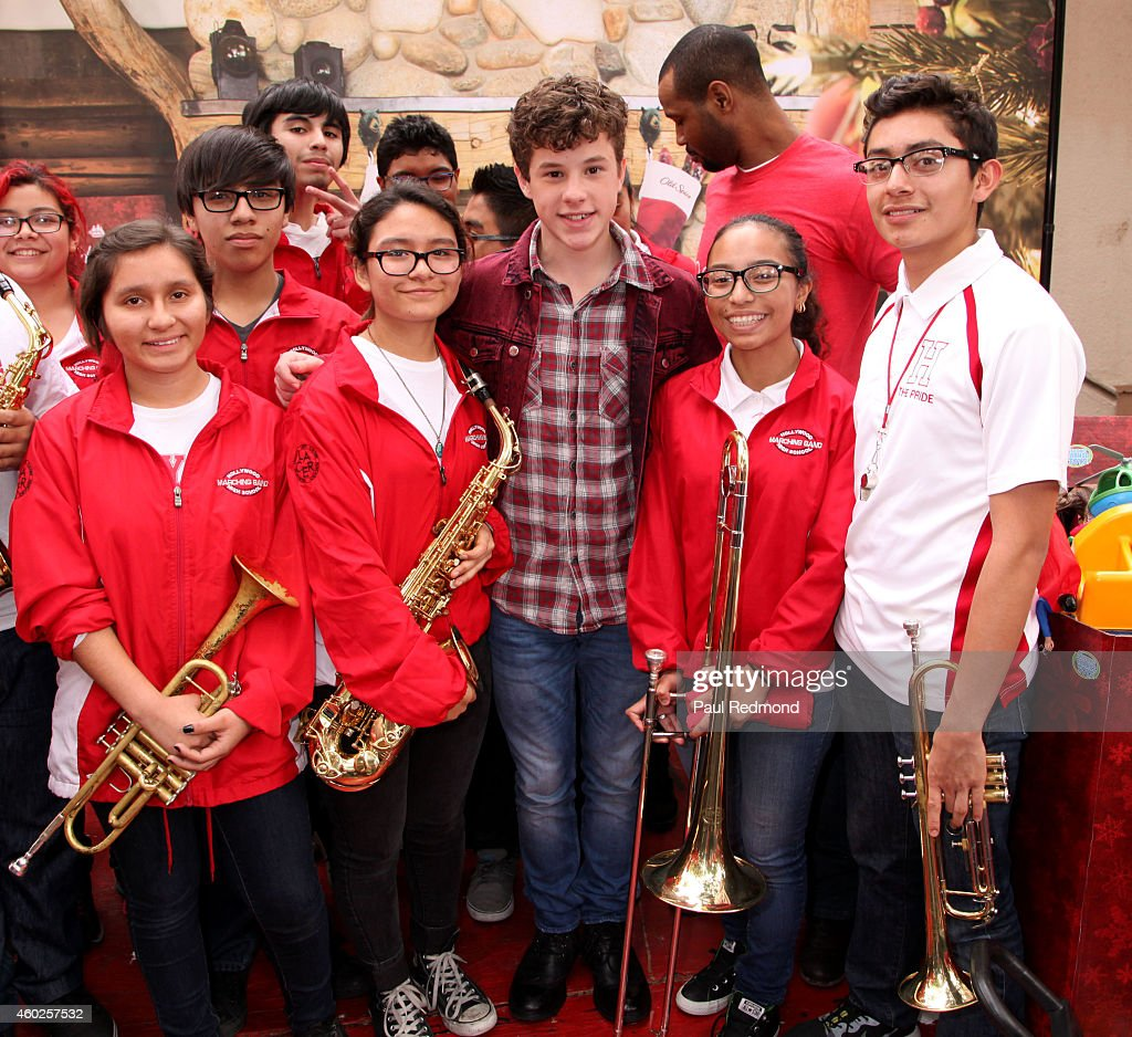Actor Nolan Gould (C) with members of the Hollywood High School marching band at the Inaugural Old Spice Holispray Holiday Toy Donation and Exchange Benefit for Second Chance Toys at Hollywood High School on December 10, 2014 in Los Angeles, California.