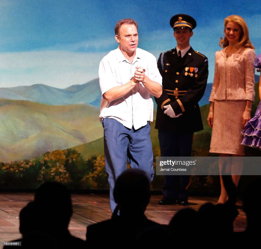 Actor Norbert Leo Butz takes a bow during curtain call at the Broadway opening night of 'Big Fish' at Neil Simon Theatre on October 6, 2013 in New York City.