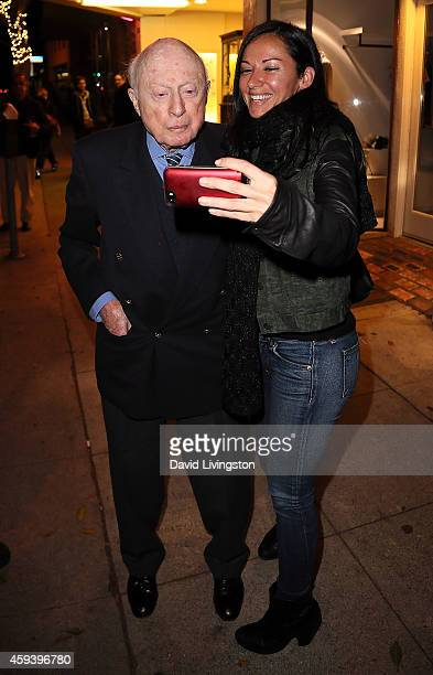 Actor Norman Lloyd and Sivan Rhodes attend the American Cinematheque film series '100 Years of Norman Lloyd' QA at the Aero Theatre on November 21...