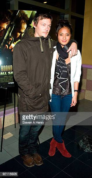 Actor Norman Reedus and model Jarah Mariano attend 'The Boondock Saints II All Saints Day' New York premiere at the Regal Union Square on October 20...