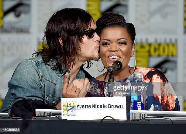 Actor Norman Reedus kisses actress Yvette Nicole Brown onstage at the TV Guide Magazine Fan Favorites panel during ComicCon International 2015 at the...