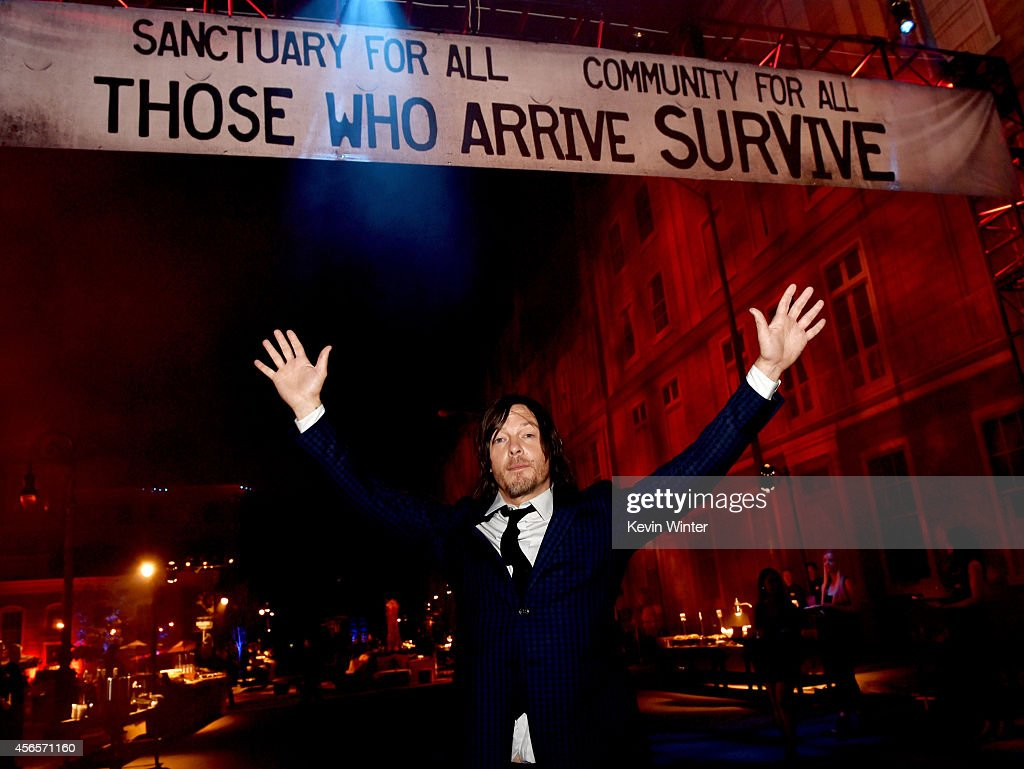 Actor Norman Reedus poses at the after party for the premiere screening of AMC Networks' 'The Walking Dead' Season 5 at the Universal Studios Backlot...