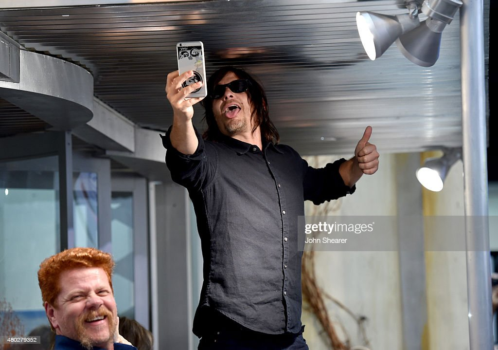 Actor Norman Reedus takes a photo at AMC's 'The Walking Dead' at ComicCon 2015 on July 10 2015 in San Diego California