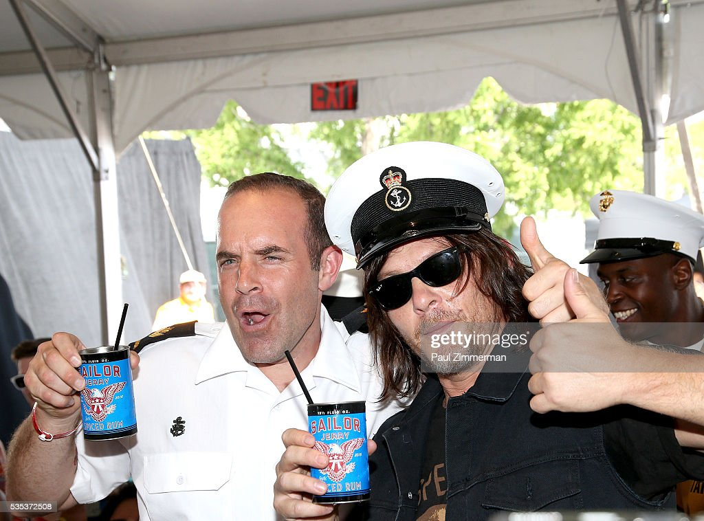 Actor <a gi-track='captionPersonalityLinkClicked' href=/galleries/search?phrase=Norman+Reedus&family=editorial&specificpeople=747258 ng-click='$event.stopPropagation()'>Norman Reedus</a> toasts the troops at Sailor Jerry Fleet Week Block Party 2016 at Pier 84 on May 29, 2016 in New York City.