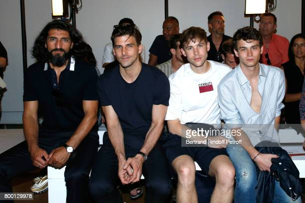 Actor Numan Acar Model Johannes Huebl Actors of the TV Series '13 Reasons Why' Tommy Dorfman and Brandon Flynn attend the Cerruti Menswear...