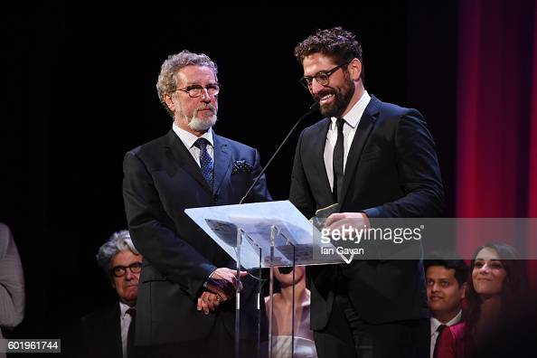 Actor Nuno Lopes holds a speech as he receives the Orizzonti Award for Best Actor for 'Saint George' with jury member Robert Guediguian during the...