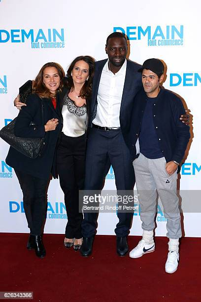 Actor of the movie Omar Sy and his wife Helene standing between humorist Jamel Debbouze and his wife Melissa Theuriau attend the 'Demain Tout...