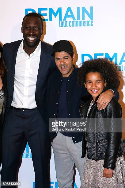 Actor of the movie Omar Sy humorist Jamel Debbouze and actress of the movie Gloria Colston attend the 'Demain Tout Commence' Paris Premiere at Cinema...