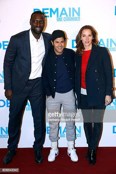Actor of the movie Omar Sy humorist Jamel Debbouze and his wife Melissa Theuriau attend the 'Demain Tout Commence' Paris Premiere at Cinema Le Grand...