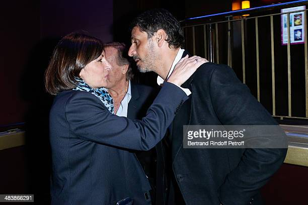 Actor of the movie Pascal Elbe and Mayor of Paris Anne Hidalgo attend the '24 Jours' Paris Premiere at Cinema Gaumont Marignan on April 10 2014 in...