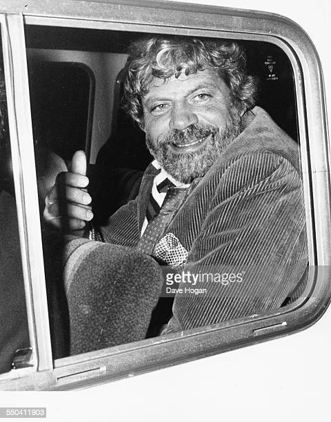 Actor Oliver Reed in the back of a van as he leaves his girlfriends 21st birthday party at Stringfellows London April 18th 1985