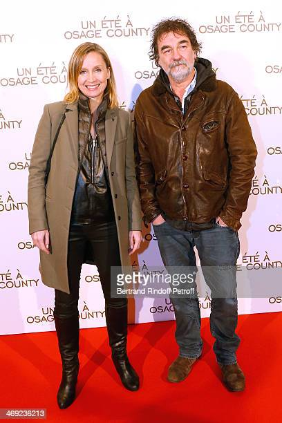 Actor Olivier Marchal with his wife Catherine Marchal attend the 'August Osage County' Premiere at Cinema UGC Normandie on February 13 2014 in Paris...
