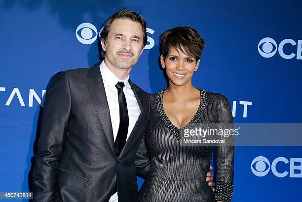 Actor Olivier Martinez and actress Halle Berry attend the Los Angeles premiere of 'Extant' at Samuel Oschin Space Shuttle Endeavour Display Pavilion...