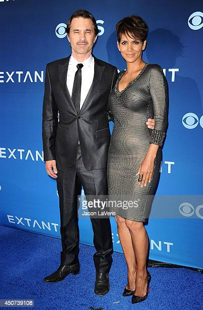 Actor Olivier Martinez and actress Halle Berry attend the premiere of 'Extant' at California Science Center on June 16 2014 in Los Angeles California
