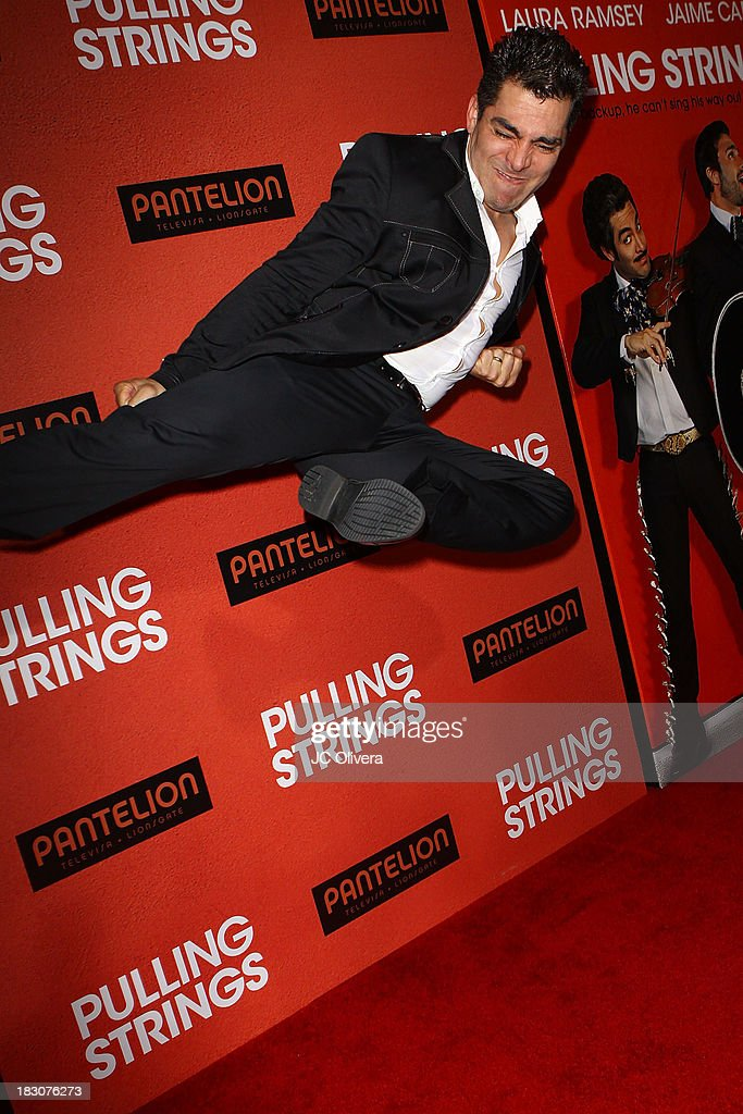 Actor Omar Chaparro attends the Los Angeles Premiere of 'Pulling Strings' at Regal Cinemas L.A. Live on October 3, 2013 in Los Angeles, California.