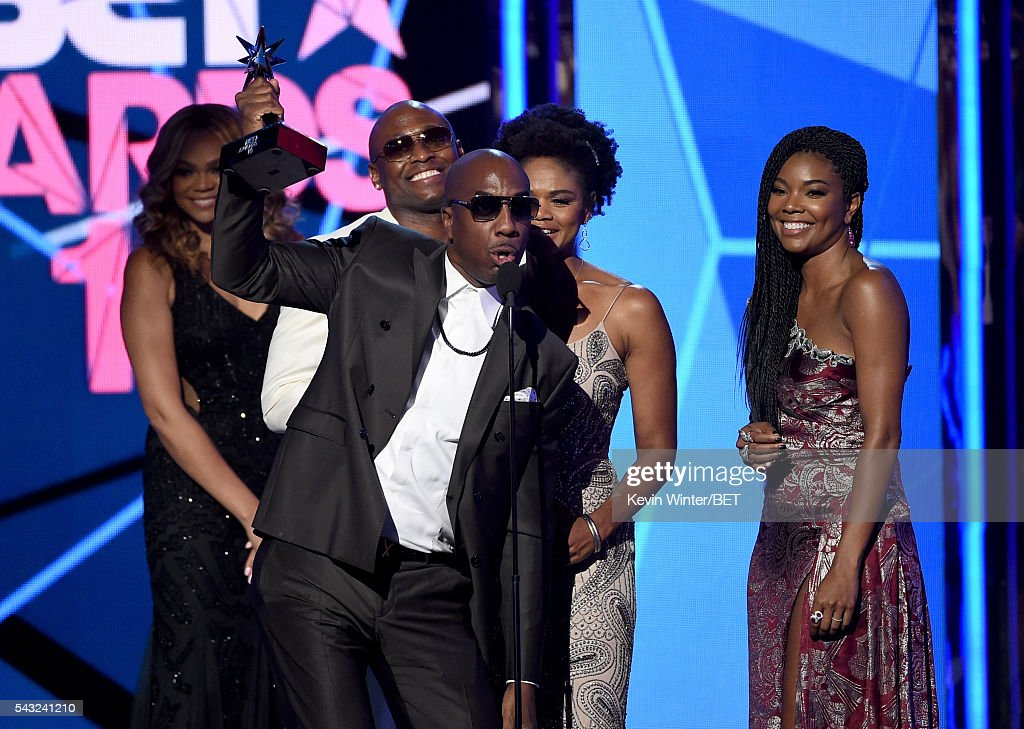 Actor <a gi-track='captionPersonalityLinkClicked' href=/galleries/search?phrase=Omar+Epps&family=editorial&specificpeople=215460 ng-click='$event.stopPropagation()'>Omar Epps</a>, actor J. B. Smoove, actress <a gi-track='captionPersonalityLinkClicked' href=/galleries/search?phrase=Kimberly+Elise&family=editorial&specificpeople=211117 ng-click='$event.stopPropagation()'>Kimberly Elise</a> and actress <a gi-track='captionPersonalityLinkClicked' href=/galleries/search?phrase=Gabrielle+Union&family=editorial&specificpeople=202066 ng-click='$event.stopPropagation()'>Gabrielle Union</a> accept the Best Male Hip Hop Artist award on behalf of winner Drake onstage during the 2016 BET Awards at the Microsoft Theater on June 26, 2016 in Los Angeles, California.