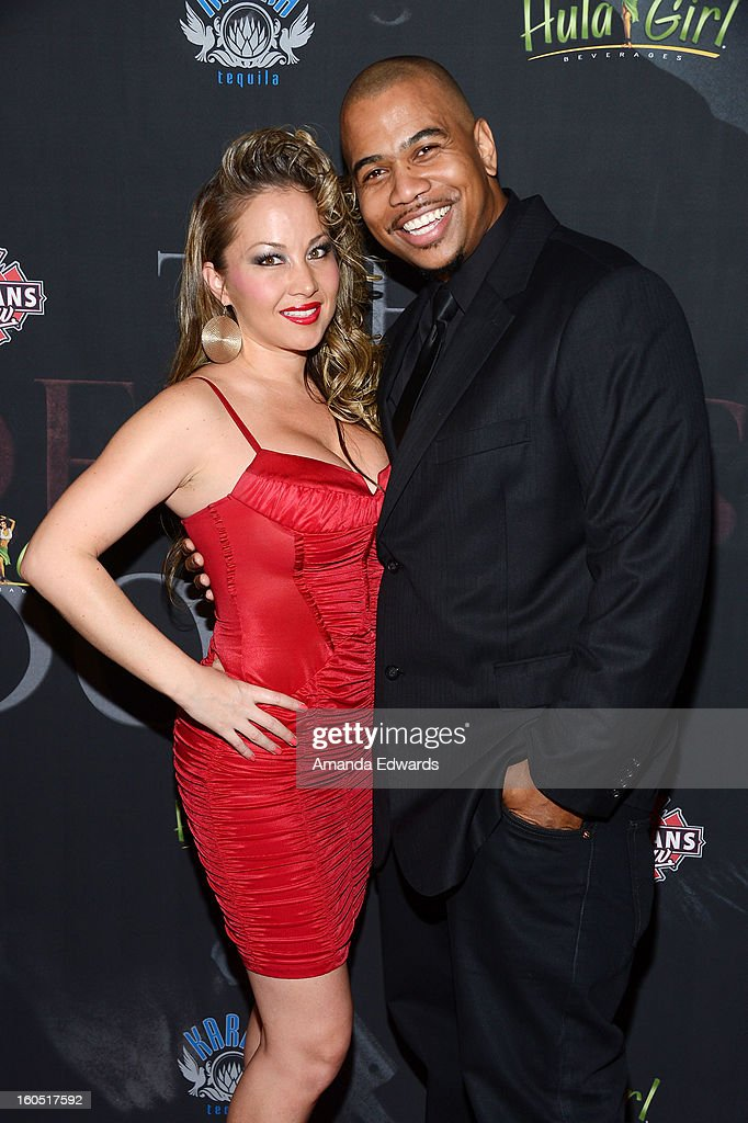 Actor Omar Gooding (R) and Mia Vogel arrive at the Los Angeles Premiere of 'The Devil's Dozen' at Mann's Chinese 6 Theatres on February 1, 2013 in Hollywood, California.