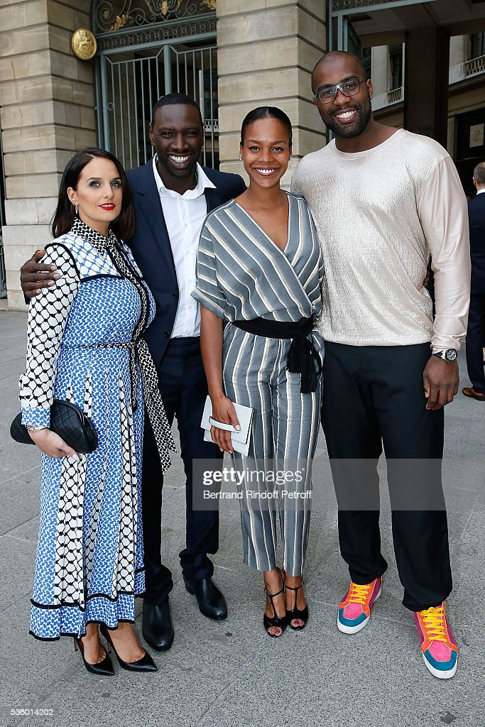 Actor Omar Sy and his wife Helene and Judoka Teddy Riner and his wife Luthna Plocus attend the Audemars Piguet Rue Royale Boutique Opening on May 26, 2016 in Paris, France.