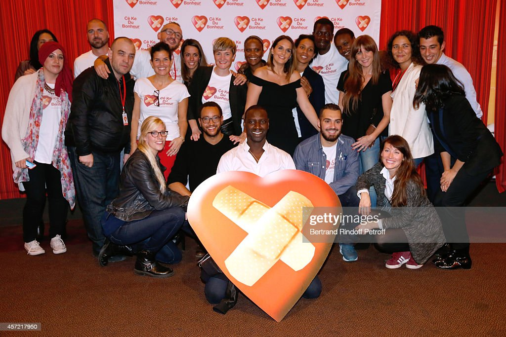 Actor Omar Sy and volunteer members of 'CekeDuBonheur' attend the Samba Premiere to Benefit 'CekeDuBonheur' which celebrates its 10th anniversary...