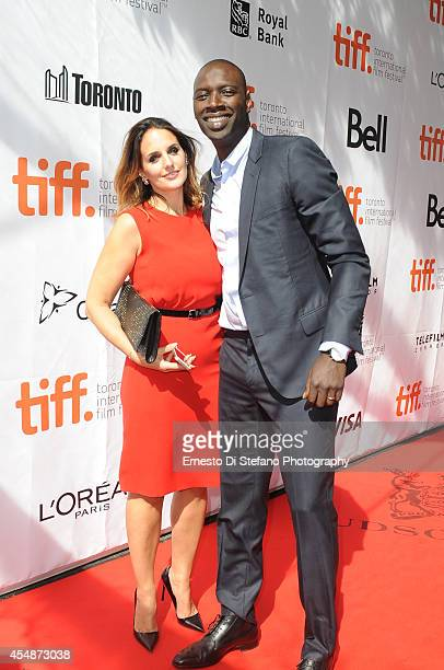 Actor Omar Sy and wife Helene Sy attend the premiere of Samba at Roy Thomson Hall on September 7 2014 in Toronto Canada