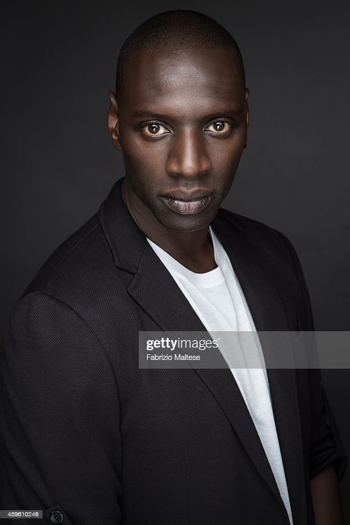 Actor <a gi-track='captionPersonalityLinkClicked' href=/galleries/search?phrase=Omar+Sy&family=editorial&specificpeople=4110364 ng-click='$event.stopPropagation()'>Omar Sy</a> is photographed for Studio Cine Live on September 7, 2014 in Toronto, Ontario.