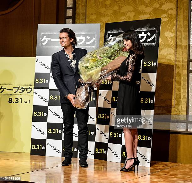 Actor Orlando Bloom and actress Nozomi Sasaki attend the press conference for the Japan premiere of 'ZULU' at the Ritz Carlton Tokyo on August 27...
