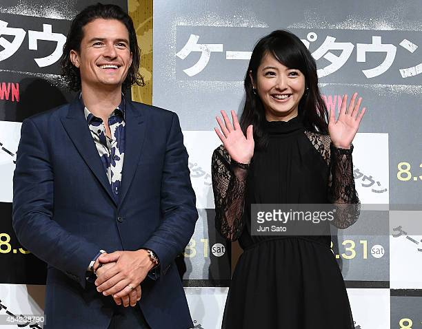 Actor Orlando Bloom and actress Nozomi Sasaki attend the 'Zulu' press conference at The Ritz Carlton on August 27 2014 in Tokyo Japan