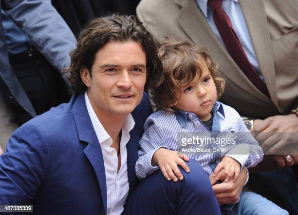 Actor Orlando Bloom and his son Flynn Bloom attend the ceremony honoring Orlando Bloom with a Star on The Hollywood Walk of Fame on April 2 2014 in...