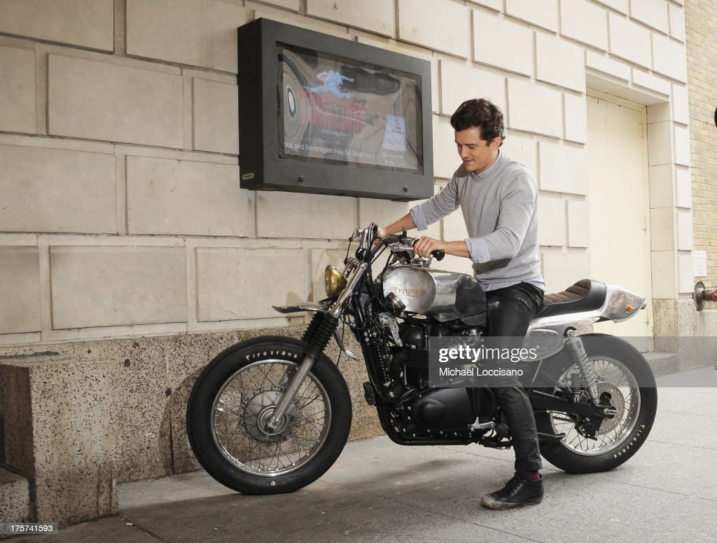 Actor <a gi-track='captionPersonalityLinkClicked' href=/galleries/search?phrase=Orlando+Bloom&family=editorial&specificpeople=202520 ng-click='$event.stopPropagation()'>Orlando Bloom</a> rides in for the 'Romeo And Juliet' Broadway photo call at Richard Rodgers Theatre on August 7, 2013 in New York City.