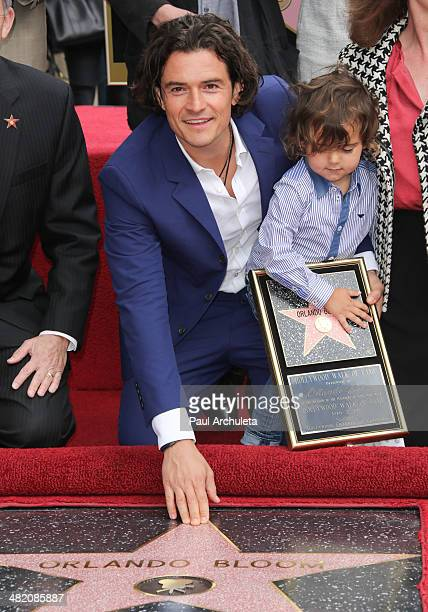 Actor Orlando Bloom with his son Flynn Bloom is honored with a Star on The Hollywood Walk Of Fame on April 2 2014 in Hollywood California
