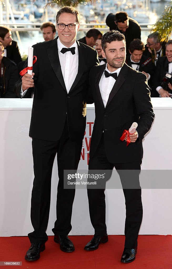 Actor <a gi-track='captionPersonalityLinkClicked' href=/galleries/search?phrase=Oscar+Isaac&family=editorial&specificpeople=2275888 ng-click='$event.stopPropagation()'>Oscar Isaac</a> (R) poses on behalf of directors Joel and Ethan Coen after they were awarded with the Grand Prix for the film 'Inside Llewyn Davis' at the photocall for award winners during the 66th Annual Cannes Film Festival at Palais des Festivals on May 26, 2013 in Cannes, France.