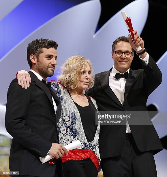 US actor Oscar Isaac poses on stage on May 26 2013 with US actress Kim Novak after he received the Grand Prix for the film 'Inside Llewyn Davis' on...