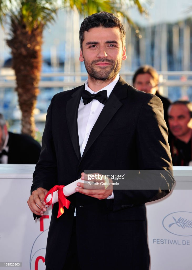 Actor <a gi-track='captionPersonalityLinkClicked' href=/galleries/search?phrase=Oscar+Isaac&family=editorial&specificpeople=2275888 ng-click='$event.stopPropagation()'>Oscar Isaac</a> poses with the 'Grand Prix' award for 'Inside Llewyn Davis' at the Palme D'Or Winners Photocall during the 66th Annual Cannes Film Festival at the Palais des Festivals on May 26, 2013 in Cannes, France.